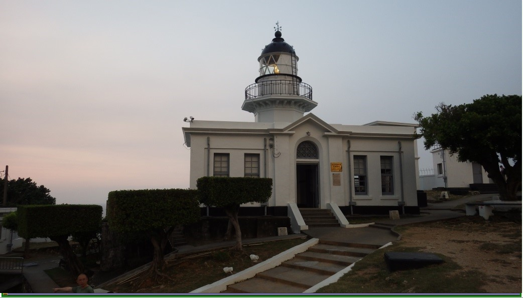 Kaohsiung Lighthouse lit up at dusk